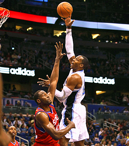 Dwight Howard helps the Magic's cause, scoring 17 points with 14 rebounds against the 76ers. (US Presswire)