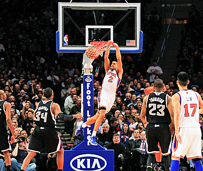 New York's Landry Fields slams home two of his team-high 15 points against the Kings. (Getty Images)