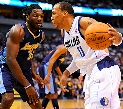 The Mavericks' Shawn Marion drives the ball past the Nuggets' Kenneth Faried in the first quarter. (US Presswire)