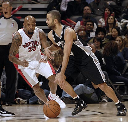Anthony Carter tries to keep up with Tony Parker, who runs circles around the Raptors with 34 points and 14 assists.  (Getty Images)