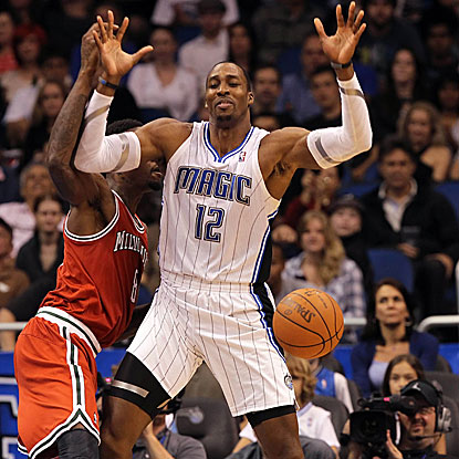 Dwight Howard records his seventh 20-point, 20-rebound game of the season in the Magic's win against the Bucks. (US Presswire)