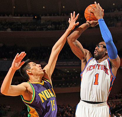 Amar'e Stoudemire matches Jeremy Lin with 26 points apiece in a losing effort to the Hornets. (Getty Images)