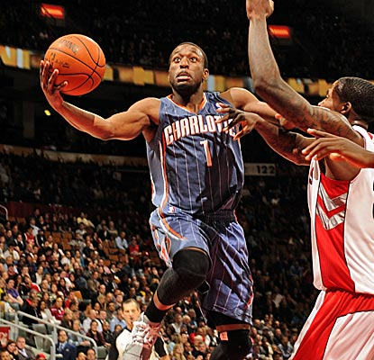 Kemba Walker scores 14 points and dishes out eight assists to help the Bobcats to their first win in over a month.  (Getty Images)