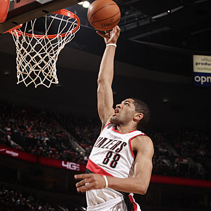 The Trail Blazers' Nicolas Batum scores a game-high 22 points, including two on a decisive fourth-quarter dunk. (Getty Images)