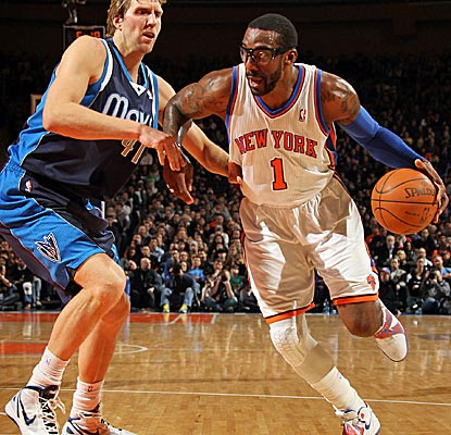 Amar'e Stoudemire scores 11 points against the Mavs, the lowest total of six Knicks in double figures.  (Getty Images)