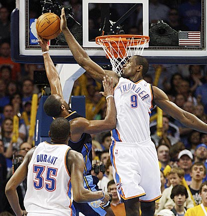 Kevin Durant gets an up-close look at one of Serge Ibaka's 11 blocked shots. Arron Afflalo is the one rejected.  (AP)