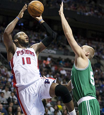 Detroit's Greg Monroe (10) shoots against Boston's Greg Stiemsma in the second half. Monroe winds up with a near triple-double. (AP)