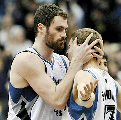 Kevin Love (left) gets a hug from Luke Ridnour after making the winning free throw with one-tenth of a second remaining.  (AP)