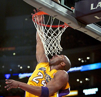 The Lakers' Kobe Bryant completes a layup during the first half against the Trail Blazers. (AP)