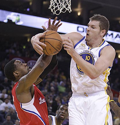 With Blake Griffin in the house, David Lee (right) is the one who registers a double-double (24 points, 13 rebounds).  (AP)