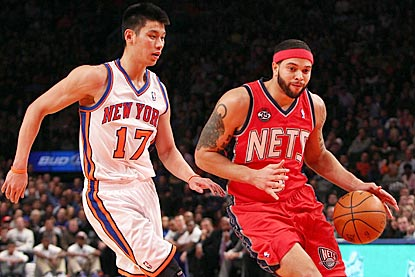 Deron Williams (right) outscores Jeremy Lin 36-11 during the first three quarters, and makes a career-high eight 3-pointers.  (US Presswire)