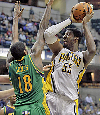 Roy Hibbert finishes with a career-high 30 points in the Pacers' 117-108 overtime win over the Hornets. (AP)