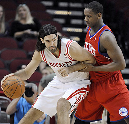 The Rockets' Luis Scola puts up a game-high 19 points and also leads all players in rebounds with 10.  (AP)