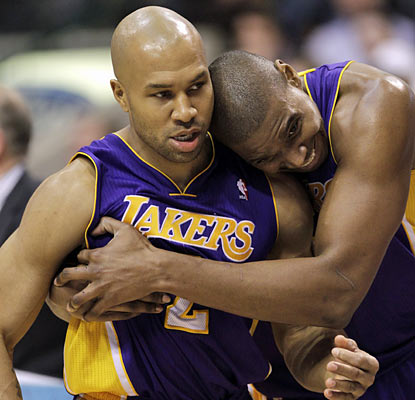 Derek Fisher (15 points) and Andrew Bynum (24 points) embrace a hard-fought win over the defending champion Mavericks.  (AP)