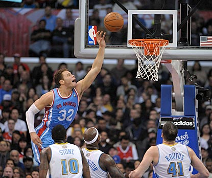 Blake Griffin is head and shoulders over the Denver Nuggets defense during a 27-point, 12-rebound performance.  (US Presswire)
