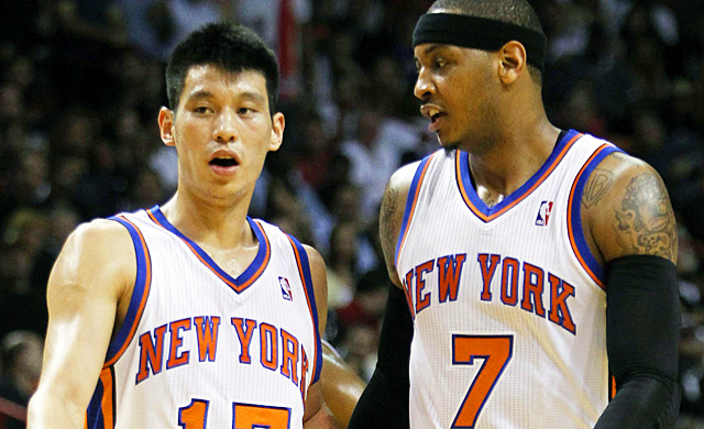 Will Carmelo Anthony (right) be able to keep the heat off himself and Jeremy Lin? (AP)