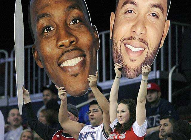 Both the Nets and the Mavericks already have cleared cap space to maneuver for Dwight Howard. (AP)