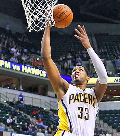 Danny Granger of the Pacers has his way against the Warriors, scoring a game-high 25 points. (US Presswire)