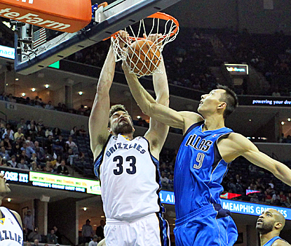 Marc Gasol of the Grizzlies follows through on a dunk during the first half against the Mavericks. (US Presswire)