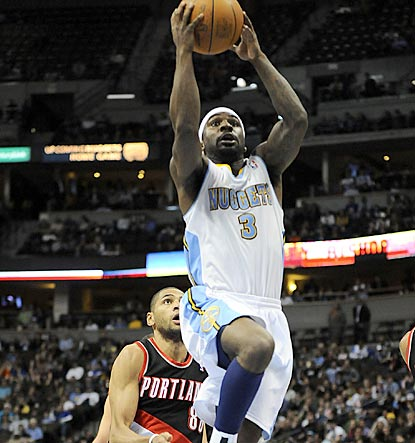 Ty Lawson soars to the hoop during the fourth quarter. He scores 18 points after a two-game absence due to an ankle injury.  (US Presswire)