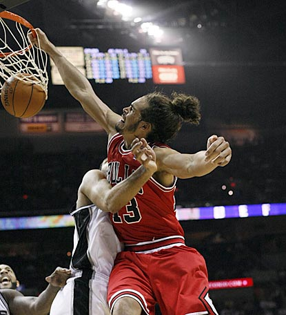 Despite Tim Duncan's defense, Bulls center Joakim Noah slams the ball home during the second half.  (US Presswire)