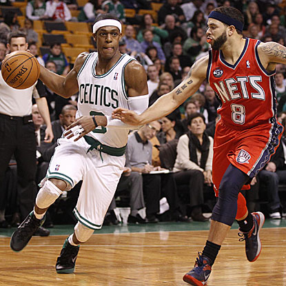 Rajon Rondo tallies 14 points and 13 assists in the Celtics' third straight victory.  (US Presswire)