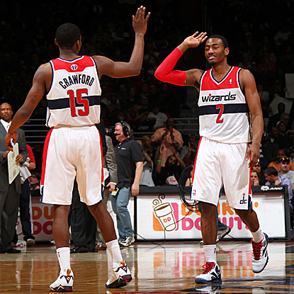 The Wizards' Jordan Crawford (left) scores 31 points and John Wall adds 24 in their win against the Cavaliers. (Getty Images)