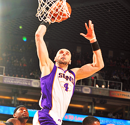 Marcin Gortat scores 14 points against the Kings but matches his season high with 17 rebounds. (Getty Images)