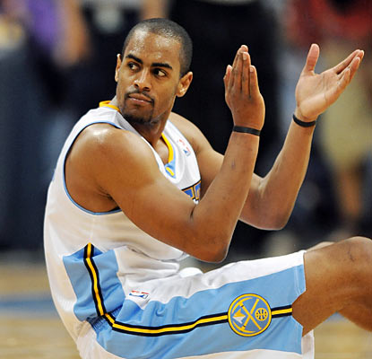Arron Afflalo puts up a career-high 32 points, including three key free throws to force overtime against the Kings. (AP)