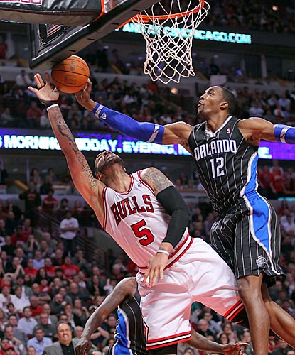 Dwight Howard blocks Carlos Boozer's shot attempt in the second half.  (US Presswire)