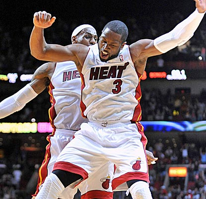 Dwyane Wade, who leads the Heat with 28 points, celebrates his game-winning shot with LeBron James.  (US Presswire)