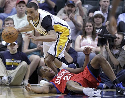 Indiana's George Hill dribbles around Philadelphia's Thaddeus Young after making a steal during the second half.  (AP)