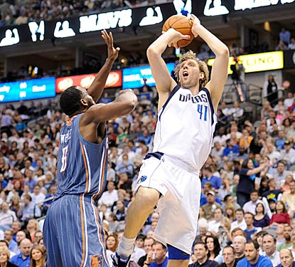 Dirk Nowitzki shoots over D.J. White during the second quarter. Nowitzki scores 27 points on 9-of-21 shooting.  (US Presswire)