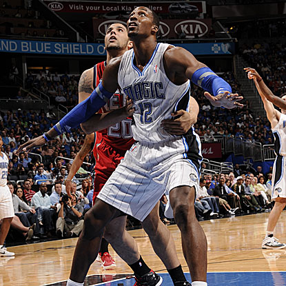 Dwight Howard shoots 8 for 10 for 18 points as the Magic cruise past the Nets for the victory.  (Getty Images)