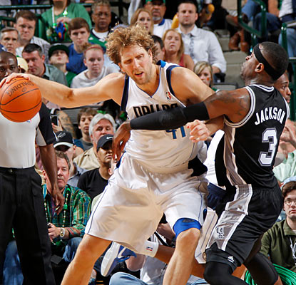 Nothing comes easy for Dirk Nowitzki, who scores 27 points against an aggressive Spurs team. (Getty Images)