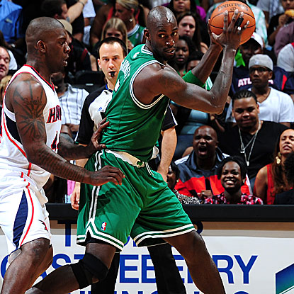 Kevin Garnett contributes 16 points as the Celtics hold off a late rally by the Hawks to win. (Getty Images)