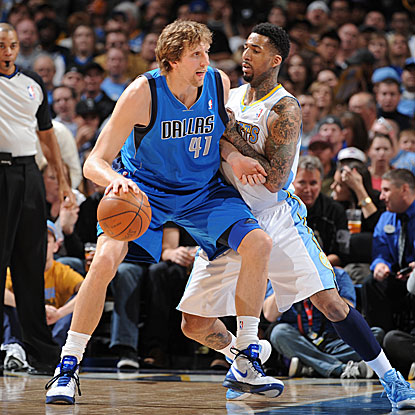 Dirk Nowitzki posts game highs with 33 points and 11 rebounds in the Maverick's win over the Nuggets. (Getty Images)
