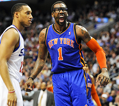 Amar'e Stoudemire reacts after a slam for two of his game-high 21 points as the Knicks get by the Sixers. (US Presswire)