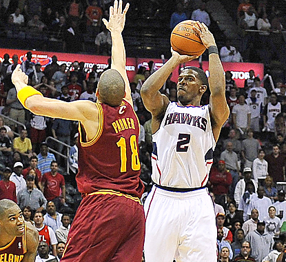 Joe Johnson scores 22 points against the Cavaliers, including this 3-pointer at the buzzer to force overtime. (US Presswire)