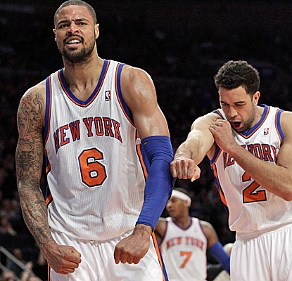 Tyson Chandler is a monster against the Pistons, scoring 15 points and grabbing 17 rebounds.   (AP)