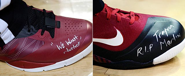 Wade (left) and LeBron wrote messages on their shoes in support of Trayvon Martin. (Getty Images)