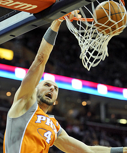 Marcin Gortat dominates the Cavaliers with 22 points and eight rebounds in a game where the Suns never trail. (US Presswire)
