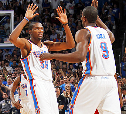 Kevin Durant celebrates with Serge Ibaka as the Thunder take a three-game lead in the race for the top spot in the West. (Getty Images)