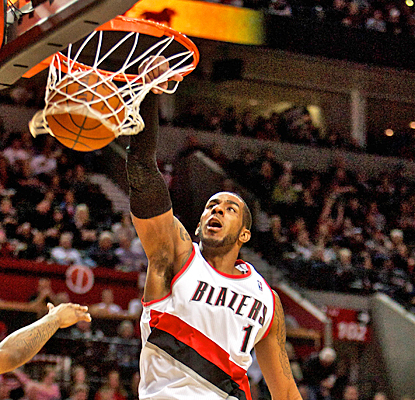 LaMarcus Aldridge slams home two of his 18 points against the Warriors as the Blazers improve to 3-3 under Kaleb Chambers. (US Presswire)