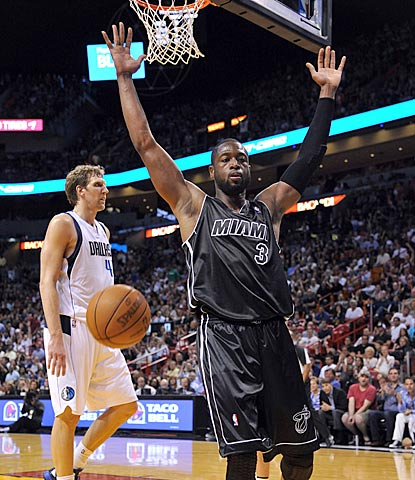 Dwyane Wade celebrates after dunking past Dirk Nowitzki (left) in the second half.  (US Presswire)