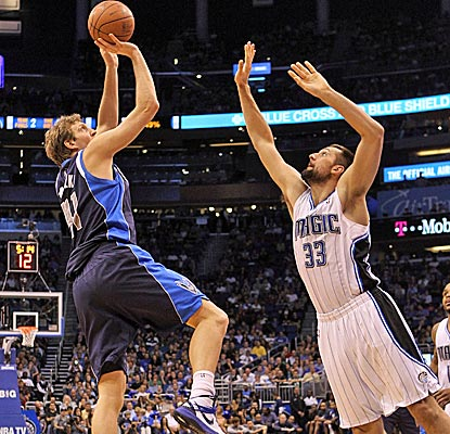 Dirk Nowitzki hits the game-winning jumper with 5.9 seconds left to beat the Magic.  (Getty Images)