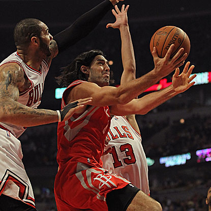 Luis Scola scores 18 points and grabs 12 rebounds as the Rockets overcome a 15-point deficit to defeat the Bulls.  (Getty Images)