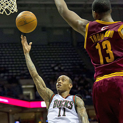 Monta Ellis contributes to Milwaukee's victory with 16 of his 30 points in the last five minutes. (US Presswire)