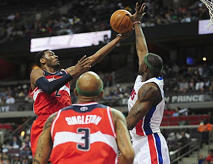 John Wall is thwarted by Ben Wallace (right) during the fourth quarter, during which Wallace makes 5 of 6 free throws.  (US Presswire)