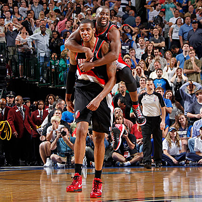 Raymond Felton leaps on LaMarcus Aldridge after he hits the game-winning jumper for the Trail Blazers.  (Getty Images)
